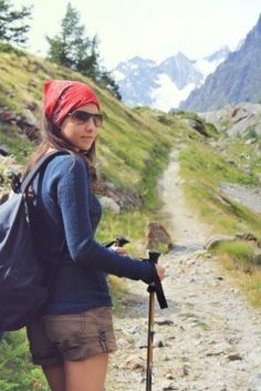 Hiking girl on high mountain trail in Aosta Valley