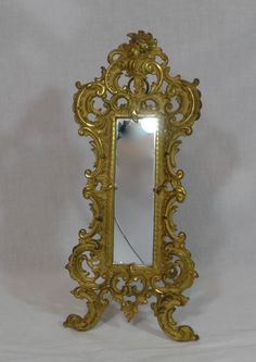 Signed Gold Gilt Iron Bradley U0026 Hubbard Easel Or Wall Hanging Mirror W/  Cherub