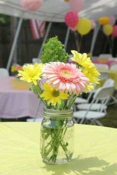 Pretty flowers in mason jars for a party table centerpiece!  See more party ideas at CatchMyParty.com!