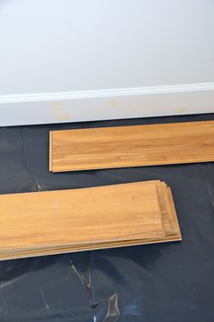 How To Install Laminate Flooring Over Concrete Laminate Flooring Basement, Installing Laminate Flooring, Vinyl Plank Flooring, Butcher Block Cutting Board, Bamboo Cutting Board, Creative Studio, Concrete