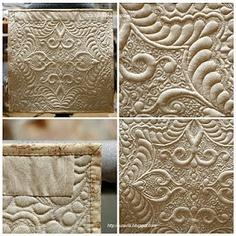 trapunto...  Beautiful machine quilting wholecloth