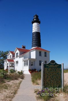 Big Sable Point Lighthouse, located in Ludington State Park, overseeing Lake Michigan. The lighthouse was built in 1867 and the tower is This lighthouse is a Michigan Historical Site. Lighthouse Lighting, Lighthouse Pictures, Beacon Of Light, Le Far West, Water Tower, Great Lakes, Lake Michigan, Abandoned Castles, Abandoned Mansions