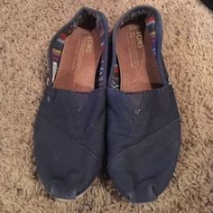 Navy Blue Toms size 5 Fairly worn navy blue Toms. Authentic. No visible tears or Rips . Just fading . TOMS Shoes Flats & Loafers