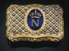 A JEWELLED GOLD AND ENAMEL NAPOLEON III PRESENTATION SNUFF BOX, RETAILED BY MAURICE MAYER, PARIS, MID 19TH CENTURY Of shaped rectangular form, the cover applied in rose-cut diamonds with the cipher of Napoleon III on a blue-enamelled oval medallion, the ground with a trellis pattern of gold and blue enamel set with further rose diamonds, rim inscribed: 'Maurice Mayer Joaillier de l'Empereur rue Basse du Rempart 20 Paris'