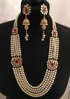 This beautifully crafted set is made with the finest quality pearls, high quality kundan and semi precious stones. Effortless chic and easy to wear. A must have for any wardrobe.