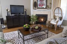 Animal print rug and beautiful hooded chair