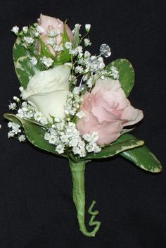 Pink and white spray roses with baby's breath and pitt leaves bout
