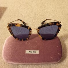 MIU MIU SUNGLASSES Authentic. Purchased from Bloomingdales in Chicago. Comes with case and box.  Style info: SMU10N 7S0-0A2 140 2N Miu Miu Accessories Sunglasses