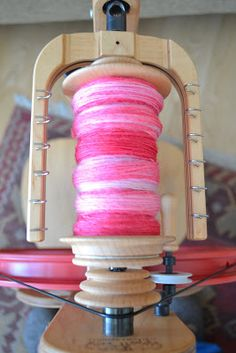 Susan B. Anderson - spinning corriedale by Dyeabolical - sweetheart colorway.