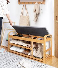 Store your shoes in a neat, modern way, and put them on with ease right by your door with the gorgeous Rilynn - Shoe Rack with Bench.Made from high quality bamboo.Versatile and space saving. Wood Shoe Rack, Shoe Rack Bench, Diy Shoe Rack, Shoe Racks, Bamboo Shoe Rack, Diy Rack, Furniture Near Me, Home Decor Furniture, Furniture Stores