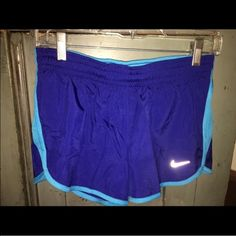 NWT NIKE 2-N-1 SHORTS SZ MED NWT NIKE 2-N-1SHORTS SZ MED.  TOP SHORT Are two shades of blue and the UNDER SHORT is a neon compression type short.  See pics! Nike Shorts