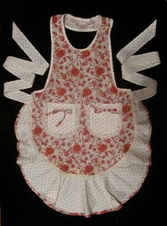 Apron with huge ruffle at the bottom trimmed in the red and white fabric, matching pockets and oh, such pretty ties.