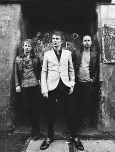 Muse are an alternative rock band from Teignmouth, England, United Kingdom. The band consists of Matthew Bellamy on lead vocals, piano, keyboard and guitar, Chris Wolstenholme on backing vocals and bass guitar, and Dominic Howard on drums and percussion.