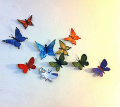 Cereal box butterfly. Outline the butterfly on the inside, cut it out, and decorate. Fold the wings & hot glue a tack or pin to the back. Pin to the wall.