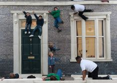 Dalston House by Leandro ErlichIt might look like these people are scaling the walls of a London townhouse but they're actually lying on the ground, reflected in a huge mirror as part of an installation by Argentinian artist Leandro Erlich.