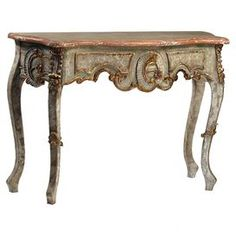 """French-style hardwood console table with hand-carved details and cabriole legs.  Product: ConsoleConstruction Material: WoodColor: GreyFeatures: Hand-carvedDimensions: 34"""" H x 47"""" W x 18"""" D"""