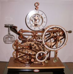 Wooden clocks, kinetic sculptures, celestial instruments and sawdust.