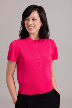 <p>This brightly coloured short sleeve cardigan is perfect for pairing with spring separates. Featuring a delicate collar and full button through, wear this knit open or closed with a statement skirt.</p>