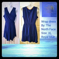 Sleeveless wrap front mini dress By:The North Face Sleeveless, wrap front the crosses and completely covers you in the front,  has the logo tag on side that states it's The North Face item, material is 100% soft cotton, size: XL, color: royal blue . The North Face Dresses Mini