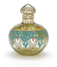 An Emberton enameled glass and silver-plate? perfume bottle circa 1900 - with interior clear glass stopper, underside signed in enamel J. P. Emberton height 5 3/4in (14.6cm)