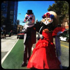 (iPhone image using Hipstamatic left-right ) Inspired by the book of life participants Gilbert Lemus and Eduardo Cuevas  walk in the traditional Day of the Dead procession from City View Plaza to San Jose State in downtown San Jose, Calif. on Sunday, Oct. 15, 2015. (Josie Lepe/ Bay Area News Group)