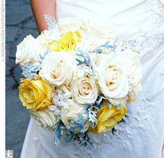 The bride's bouquet was comprised of ivory Vendela and yellow Skyline roses with stephanotis and dusty miller, the light blue adding a pop of color to the blooms.