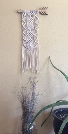 Add some fun to your wall with this macrame wall hanging! Woven with cotton onto a wood arrow. There are two small holes drilled into back of arrow for easy hanging. The measurements (with arrow) are 8 wide by 16 long  Made with love and ready to ship! For orders outside of the U.S. please send me a convo for a shipping quote