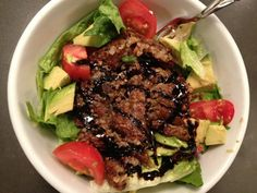 Refreshing Salad (avocado, tomato, romaine) topped with veggie burger + balsamic = lunch perfection