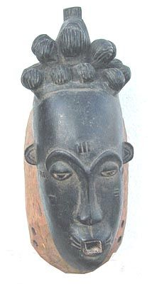 "African Baule Mask, elegantly carved with detailed coiffure in traditional Baule style. Half almond eyes, square mouth, scarification on brow and cheeks. Acquired from the collecction of Dr. Mamadou Diop in 1993. 15"" high.  ca. 1940s US$625"