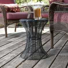 Holly & Martin Metal Spiral Accent Table - Black by Holly & Martin. $54.50. A modern and contemporary design make this black wire accent table a fabulous decorative piece for any home. Designed with layers upon layers of wire, this table is both functional and stylish. Whether you place this accent table beside your sofa or on your patio it is sure to enhance your decor. Try creating symmetry with two tables on either side of a sofa for a look that is sure to please!