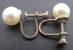 Vintage pearl screw back earrings 1940s -1950s - They were little torture devices. If you expected them to stay on they had to be screwed down pretty tightly.