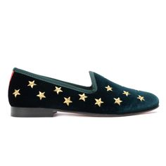 Women's Green Velvet Slippers With Gold And Silver Stars. Gold Star Embroidery on the Left Shoe and Silver Star Embroidery on the Right Shoe. Signature Red Grosgrain Heel Stripe. Leather Sole and Lining. Brown Stacked Wooden Heel. Handmade in Italy.