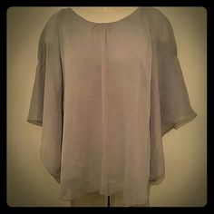 Express Gray top Sheer top with attached tank underneath.  Loose fitting with hidden sleeves (see pic 2).  Worn a couple of times. Express Tops