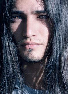 ... amazing black hair & amber eyes... would make a spectacular portrait/drawing.