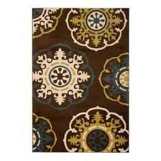 Loomed rug with a medallion motif.   Product: RugConstruction Material: PolypropyleneColor: Brown, green and multiFeatures: Power-loomedNote: Please be aware that actual colors may vary from those shown on your screen. Accent rugs may also not show the entire pattern that the corresponding area rugs have.Cleaning and Care: Professional cleaning recommended