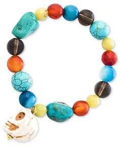 Incorporate a little fierce fashion. This edgy stretch bracelet combines chunky beads in carnelian, smoky quartz, dyed-blue white turquoise, lemon quartz, blue quartz  and a white howlite skull charm.
