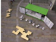 The open-sided container was painted a particular lime green and the interior decorated by artist Richard Woods, offering a visually arresting back drop to the fully functioning coffee bar. Container Bar, Container Conversions, Urban Furniture, Cabin Homes, Storage Containers, Picnic Table, Landscape Architecture, Installation Art, Interior Decorating