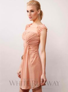 Charlie Cocktail Dress. A beautiful and delicate cocktail length dress with sheer mesh upper with petal detailing on shoulders. Available in a full length version here.