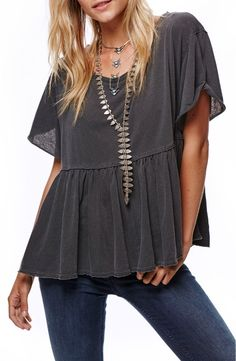 In love with this easy, oversized scoop-neck tee finished with a girlish peplum hem.