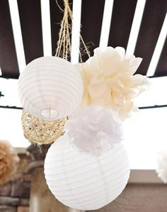 Pretty way to pair plain paper luminaries with pretty paper floral features. Could be done with some white and some colors together and would also be very pretty! WeddingChannel Galleries: Madeline & Andrew's Wedding