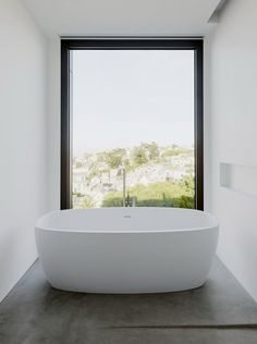 This white tub captures the minimalist vibe of this San Francisco home