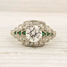 Diamond emerald and platinum ring