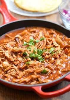 Mexican shredded chicken dish with tomatoes and chipotle chilis in adobo sauce. This authentic chicken tinga is hearty, tasty and perfect for tacos, enchiladas, tostadas or as main meal. Mexican Chicken Tinga Recipe, Mexican Shredded Chicken, Chicken Recipes, Recipes With Shredded Chicken, Chicken Meals, Bread Recipes, Tostadas, Best Mexican Recipes, Ethnic Recipes