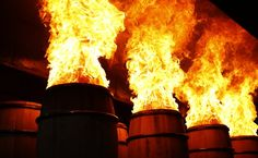 The process of charring barrels for bourbon, whiskey, etc.