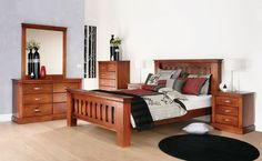 Texas rustic heavy warm wooden bedroom furniture suite with black, grey and red linen and décor