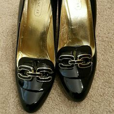 COACH Heels Shiny black and gold buckle heels super cute..worn but still in good condition...no scuffs or scratches...it's size 8 bit fits like a 7 1/2 RUNS SMALL Coach Shoes Heels