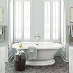 """""""Laid out in a pattern, this Ann Sacks tile gives the same graphic punch as a painted floor but is much more practical for a bath,"""""""