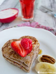 These gluten free, berry banana pancakes are a quick and healthy alternative to ordinary pancakes. Filled with three fruits and nuts, they're sure to please even the pickiest eater. Use a heart-shaped cookie cutter for a festive Valentine's Day breakfast!