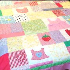 Quilt made of first year onsies. I want to do this SO bad!