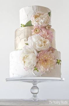Floral Wedding Cakes This gorgeous wedding cake features metallic gold and ivory buttercream and soft fresh floral. Cake design made by The Pastry Studio located in Daytona Beach, Florida. Floral Wedding Cakes, Elegant Wedding Cakes, Wedding Cake Designs, Wedding Cake Toppers, Floral Cake, Wedding Flowers, Beautiful Wedding Cakes, Gorgeous Cakes, Pretty Cakes